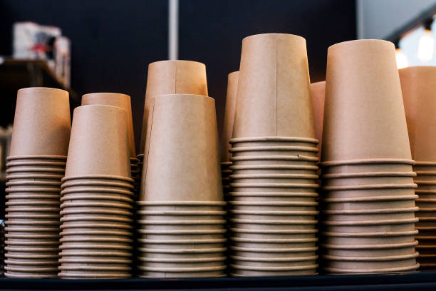 stack of disposable coffee cup, selective focus - paper coffee cup stock photos and pictures