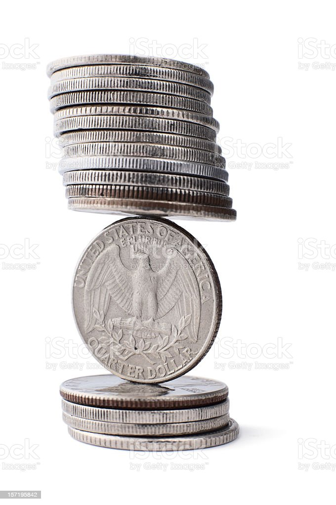 Stack of dollars in a weird balance royalty-free stock photo