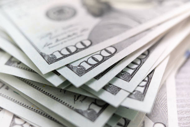 stack of dollars spread out stack of dollars spread out money bills and currency stock pictures, royalty-free photos & images