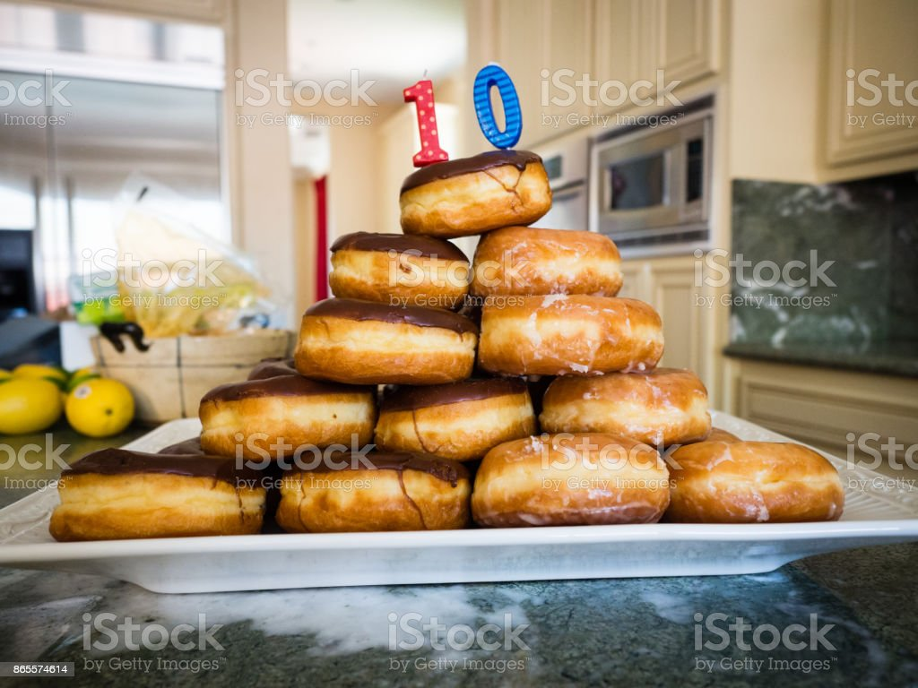 Stack of Doughnuts with 10 Year Old Birthday Candle stock photo
