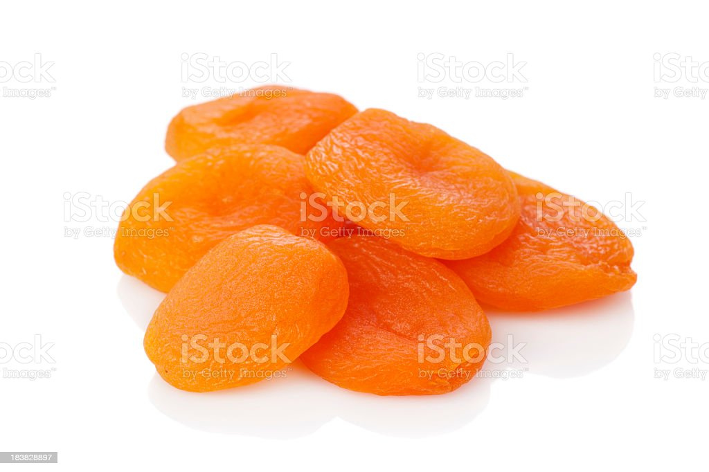 A stack of dried apricots against a white background stock photo