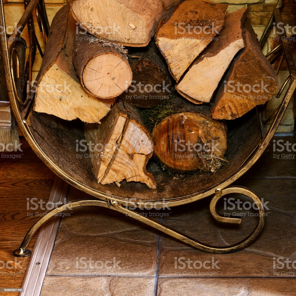 Stack Of Dry Firewood And Fireplace Accessories Stand Near House