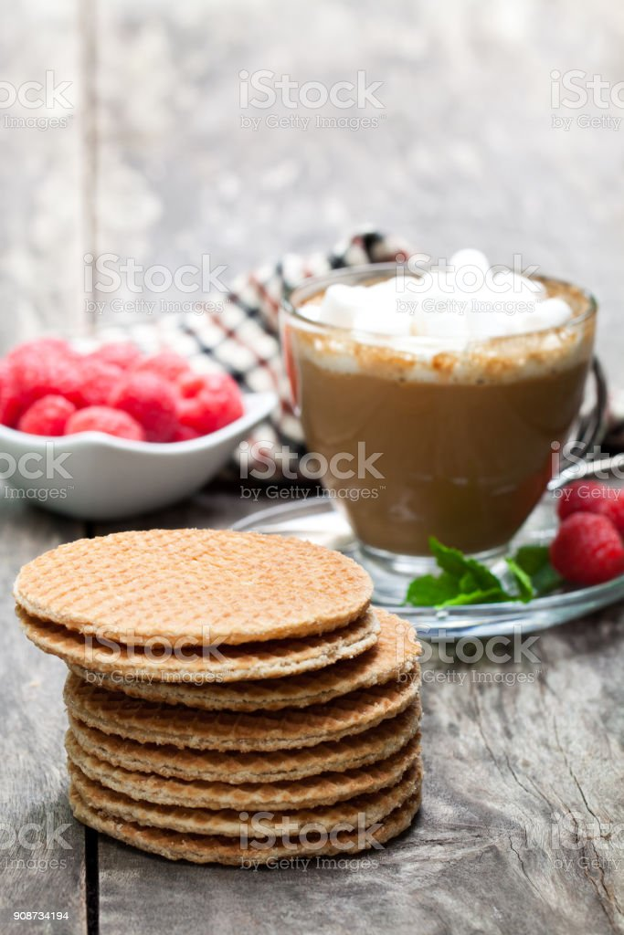 Stack  of Dutch caramel waffles with fresh raspberry and cup of coffee stock photo
