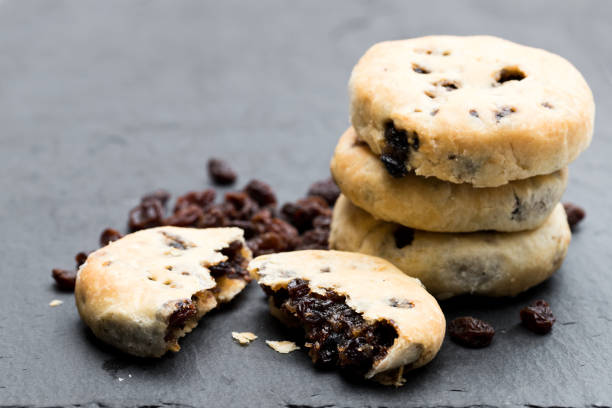 Stack of Eccles cakes on black stone background Stack  of Eccles cakes on black stone background northwest england stock pictures, royalty-free photos & images