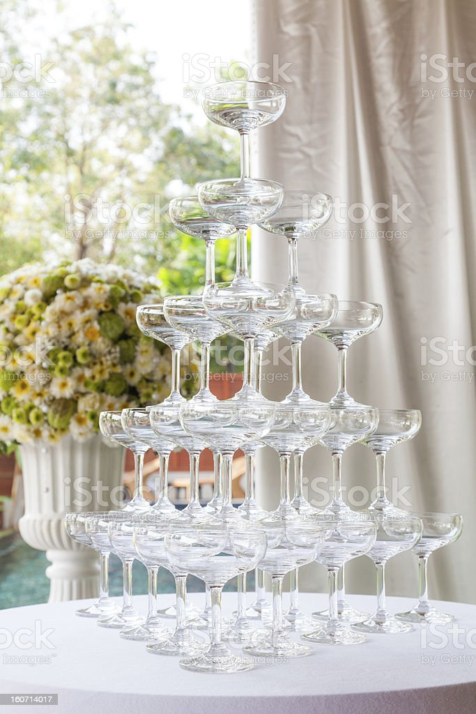 Stack of Empty champagne / wine glasses on table royalty-free stock photo