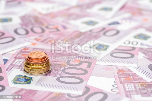 istock stack of euro coins on paper money 1059569120