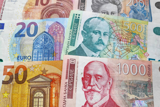 Stack of Euros & Serbian dinar stock photo