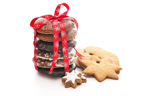 a stack of festive christmas shortbread cookies - christmas cookies stock pictures, royalty-free photos & images