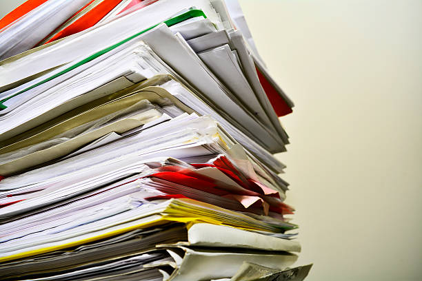 Stack of files on his desk stock photo