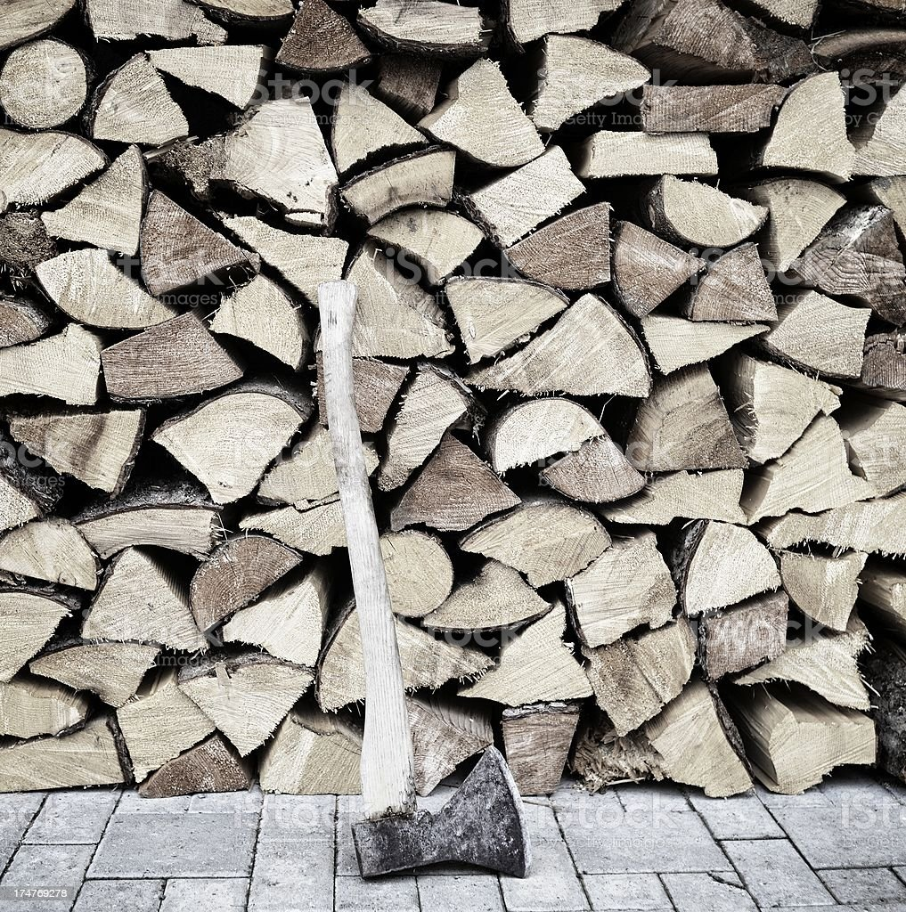 Stack of Firewood and Axe royalty-free stock photo