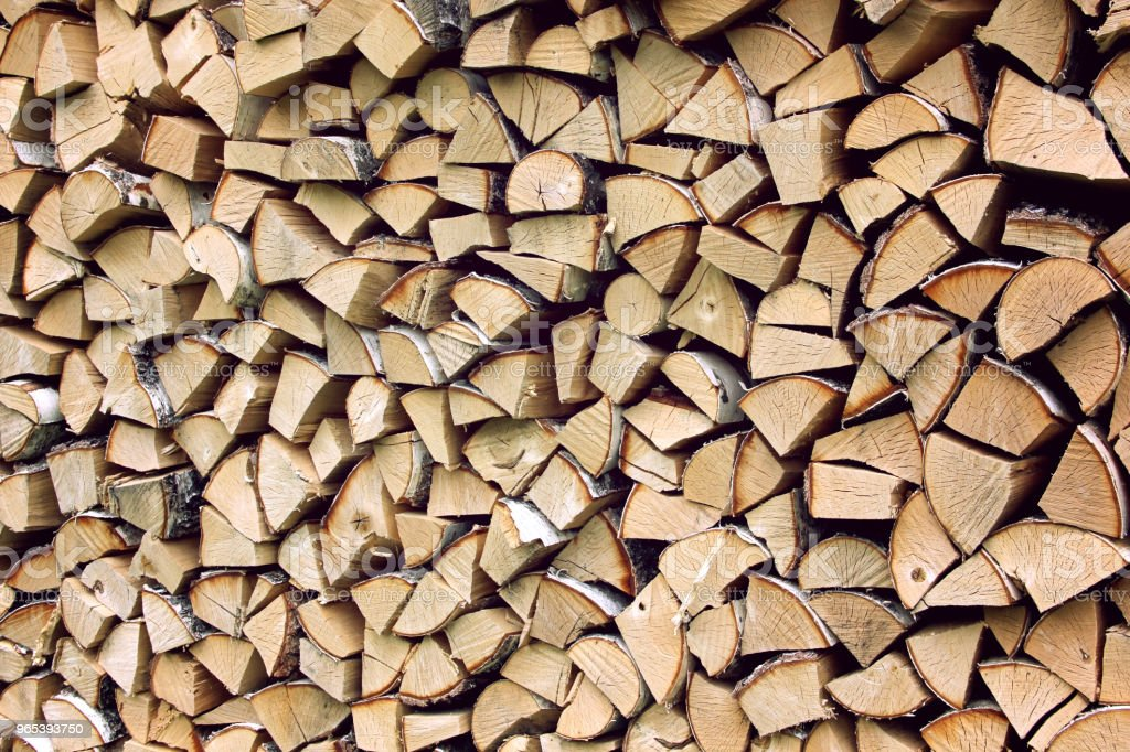 Stack of firewood, wooden abstract background. royalty-free stock photo