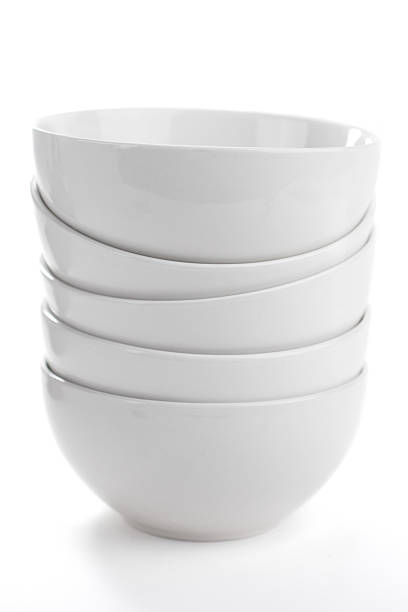 Stack of five deep white bowls isolated on white background stock photo