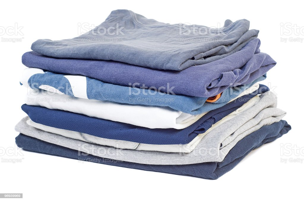 Stack of folded blue clothes isolated on a white background royalty-free stock photo
