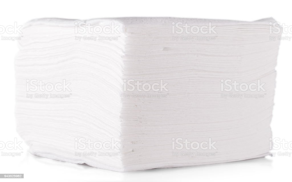 Stack of folded disposable paper tissues on white background. stock photo