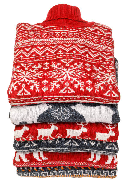 Stack of folded knitted Christmas turtleneck sweaters on white background stock photo