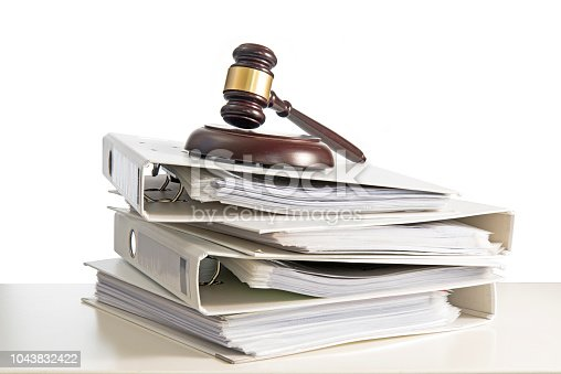 istock stack of folders and a judge gavel on a desk, isolated on a white background, concept for justice, business and finance, copy space 1043832422