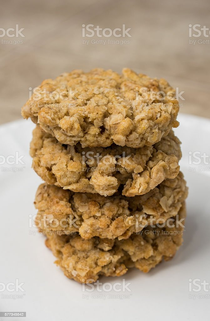 Stack of four oatmeal cookies on white plate stock photo