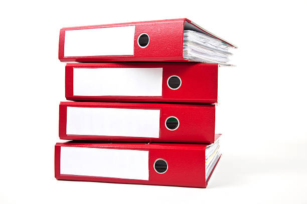 Stack of four red ring binders with spine facing viewer red ring binders against a white background ring binder stock pictures, royalty-free photos & images