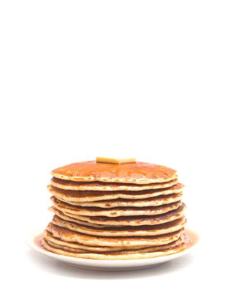 a stack of fresh buttermilk pancakes with butter and syrup on a white background - pancake foto e immagini stock