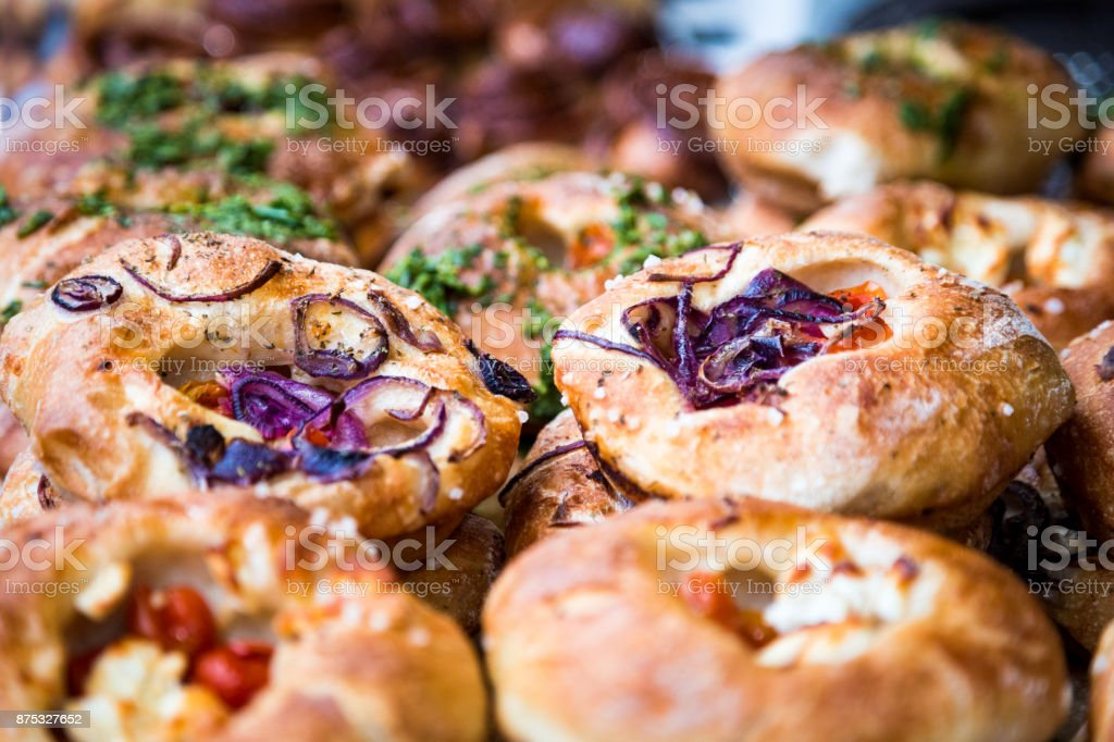 Stack of freshly baked artisan breads and focaccia piled on top of each other stock photo
