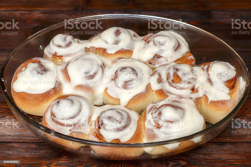 Stack of freshly cinnabon, French buns with cinnamon and cream stock photo