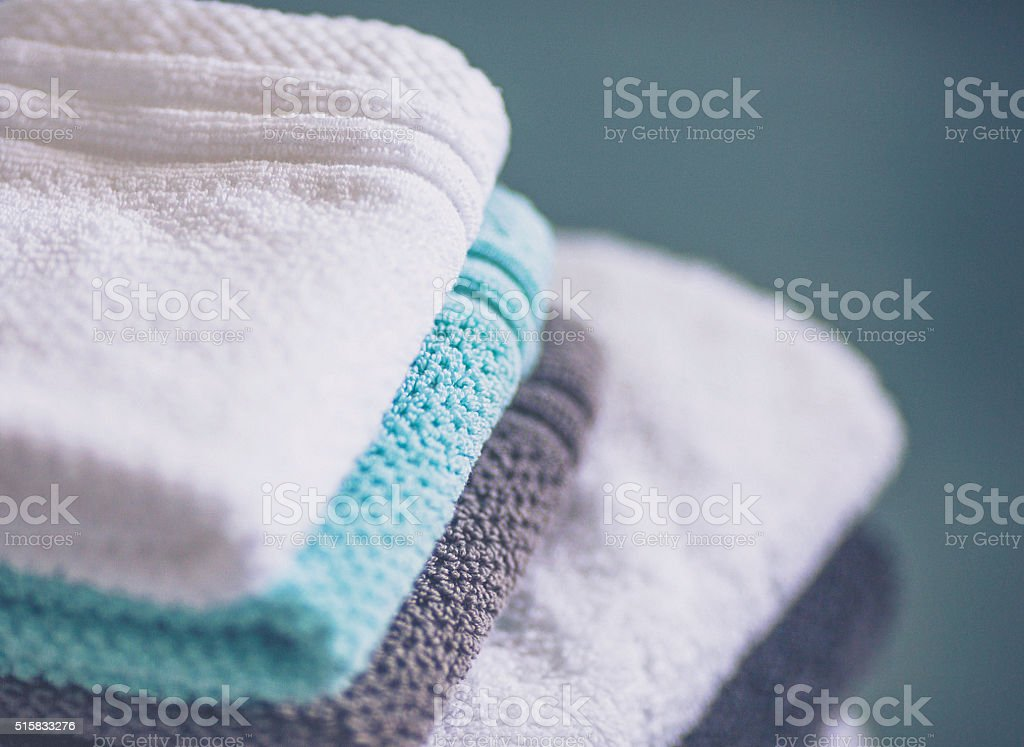 Stack of freshly laundered towels and washcloths stock photo
