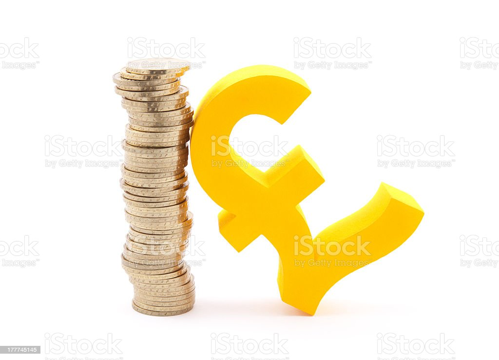 Stack of gold coins and pound symbol royalty-free stock photo