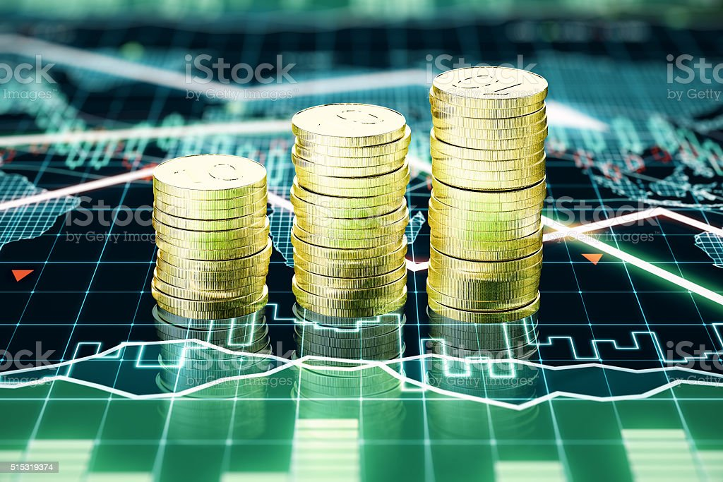 Stack of gold coins on business chart stock photo