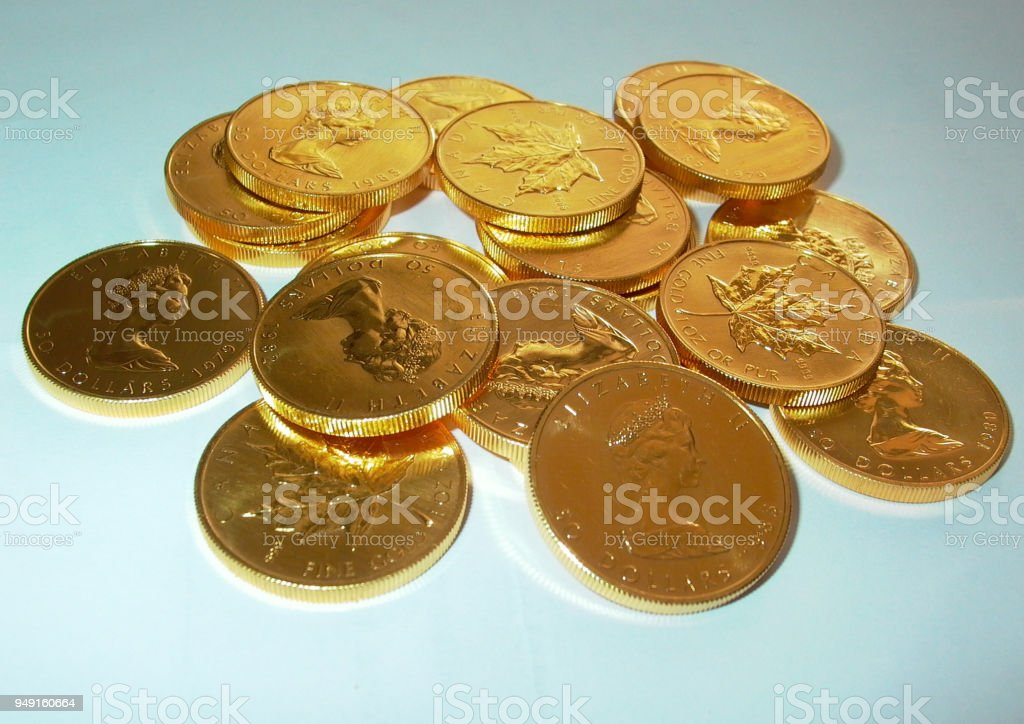 Stack of gold ounces Canada Maple Leaf Elizabeth II. Pur fine Gold 31,1 Gramm stock photo