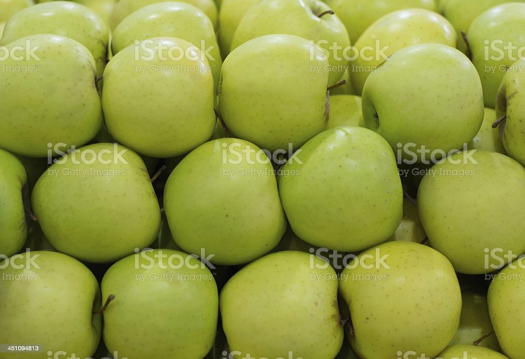 stack of green apples in rows royalty-free stock photo