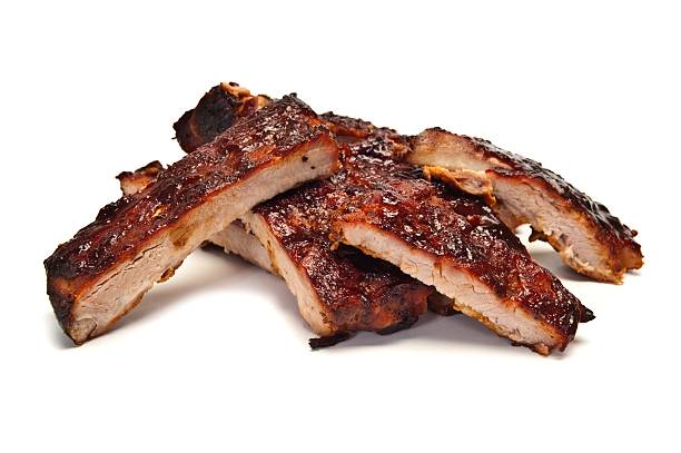 A stack of grilled pork ribs on a white background