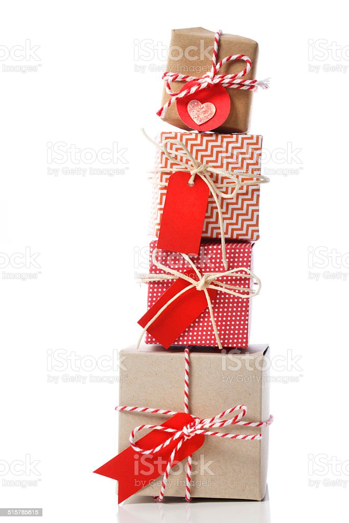 Stack of handcraft gift boxes Stack of handcraft red colored gift boxes on white background Art And Craft Stock Photo