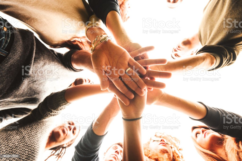 stack of hands for the teamwork of friends stock photo