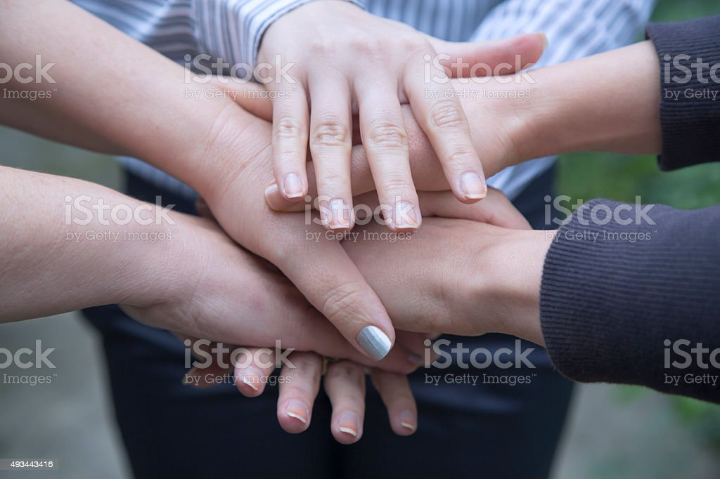 Stack of hands gathering in unity. stock photo