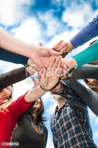 istock Stack of hands of volunteer 510389250