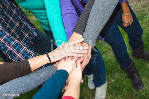 istock Stack of hands of volunteer 512208878
