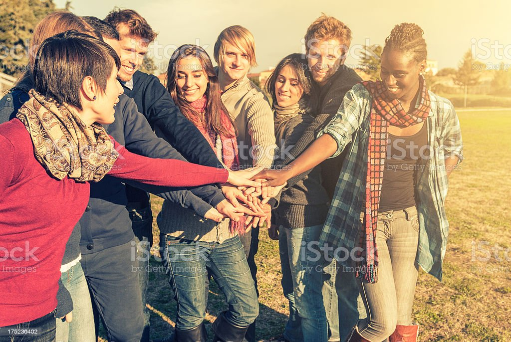 Stack of hands - people friendship royalty-free stock photo