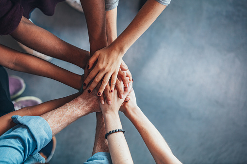 istock Stack of hands showing unity 625736338