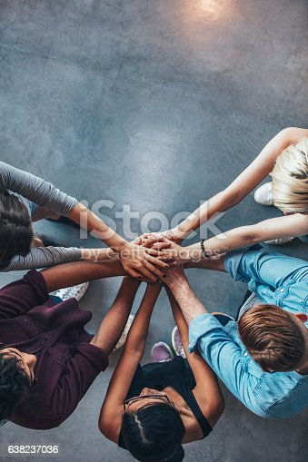 istock Stack of hands symbolizing trust and cooperation 638237036