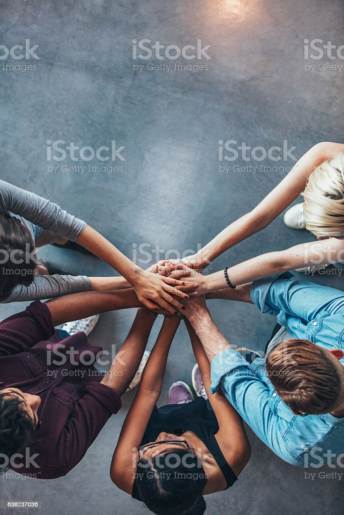 Stack of hands symbolizing trust and cooperation stock photo