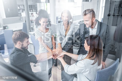 istock Stack of hands. Unity and teamwork concept. 1016777016