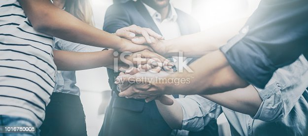 istock Stack of hands. Unity and teamwork concept. 1016780008