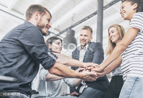 istock Stack of hands. Unity and teamwork concept. 1016780128
