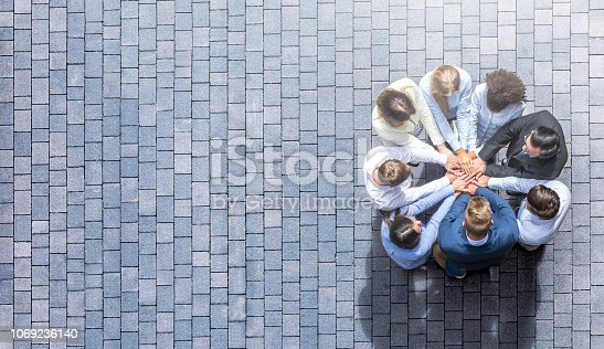 istock Stack of hands. Unity and teamwork concept. 1069236140