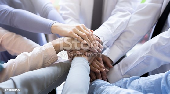 832105860 istock photo Stack of hands. Unity and teamwork concept. 1174509862