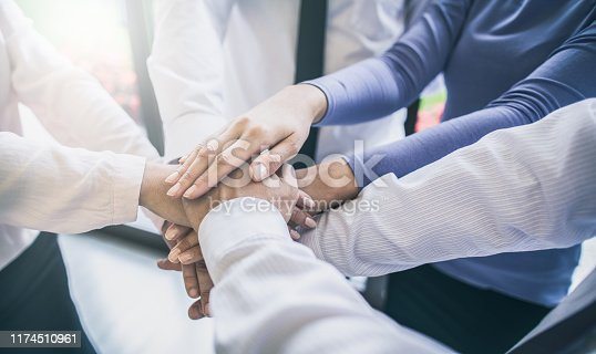 832105860 istock photo Stack of hands. Unity and teamwork concept. 1174510961