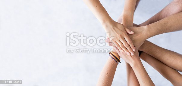 832105860 istock photo Stack of hands. Unity and teamwork concept. 1174510981