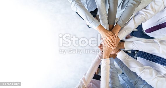 istock Stack of hands. Unity and teamwork concept. 1174511028