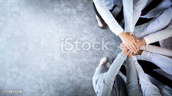 832105860 istock photo Stack of hands. Unity and teamwork concept. 1174511219