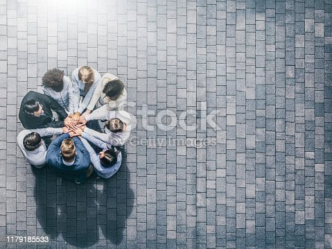 832105860 istock photo Stack of hands. Unity and teamwork concept. 1179185533